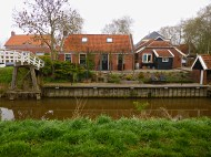 Mensingeweer from the other side of the canal, footbridge on far left.